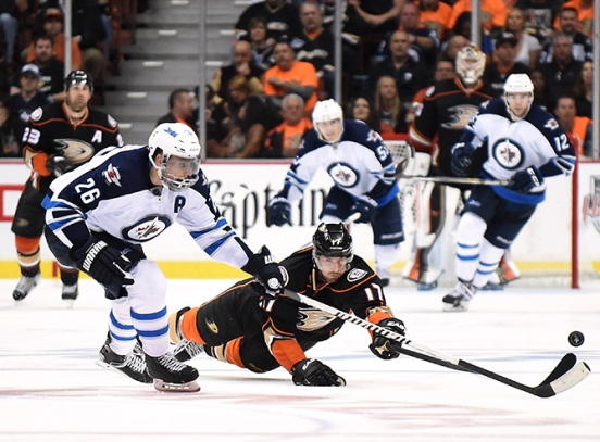 ANAHEIM, CA - APRIL 16: Ryan Kesler #17 of the Anaheim Ducks dives as he knocks the puck from Blake Wheeler #26 of the Winnipeg Jets during the third period in Game One of the Western Conference Quarterfinals during the 2015 NHL Stanley Cup Playoffs at Honda Center on April 16, 2015 in Anaheim, California. The Ducks won 4-2. (Photo by Harry How/Getty Images)
